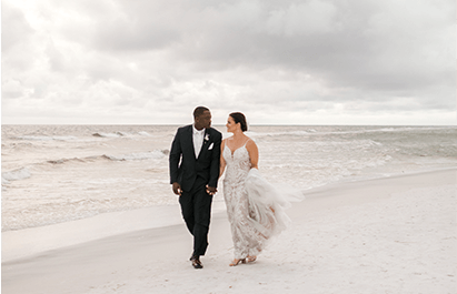 bride and groom on the beach at Hilton Sandestin Beach